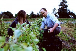 Jesse and Lisa filling a box with fresh vegetables. Photography by Janae Alyssa Lloyd