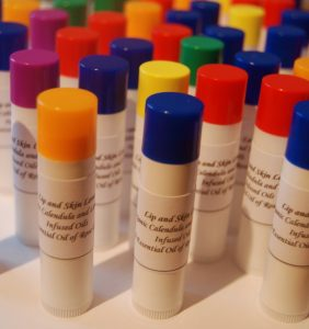 A photo of many versions of Hedda Chapstick products